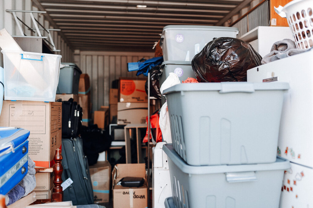 Storage unit with a large variety of items, contributing to being overwhelmed with moving